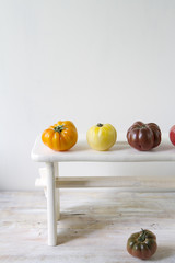 Tomatoes on white stool