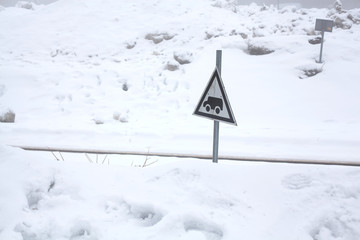 winter- covered by snow the railway crossing