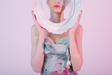 Beautiful Woman in Floral Dress Holding White Oval Frame