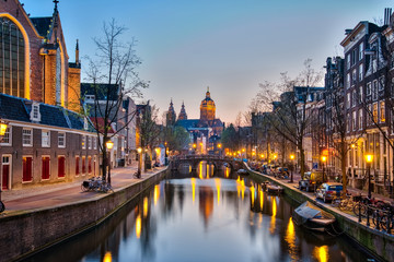 Amsterdam city at night with the canal in Amsterdam city, Netherlands