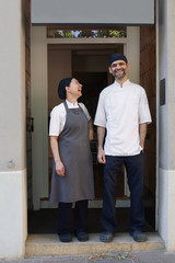 Portrait of artisan bakers at the entrance of their bakery