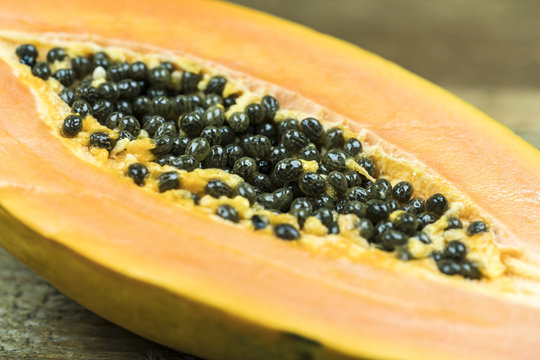Close up view of papaya with numerous black seeds