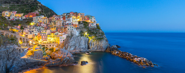 Poster Europa Manarola village one of Cinque Terre at night in La Spezia, Italy