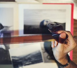 Photographer looking at some film