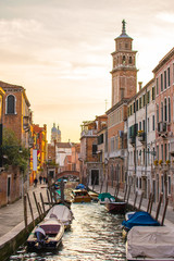 Sunset view with canal in Venice, Italy