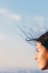 Portrait of a young woman with hair blown by the wind
