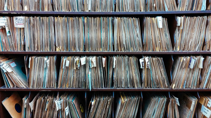 jazz record albums lined up on shelves