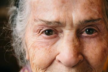 Eyes close up of senior woman. Happy grandmother