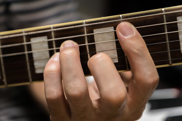 electric guitar close-up playing chord for rock music