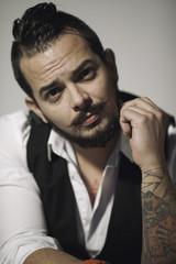 Portrait of a tattooed urban man
