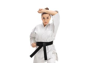 Girl in a kimono doing a karate kata