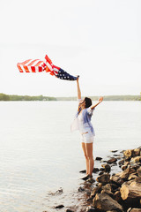 Girl waving an american flag
