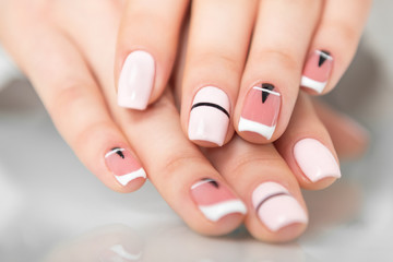 Aluminium Prints Manicure Beautiful female hands with a fashionable manicure. Geometric design of nails. Photo closeup