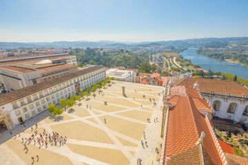 Coimbra uptown aerial view from top of bell clock tower. Coimbra University courtyard and Mondego river on background. Coimbra in Central Portugal, is famous for its University, the oldest in Europe.