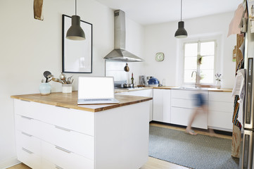 Germany, North-Rhine-Westphalia, Cologne, laptop in a modern kitchen in an old country house