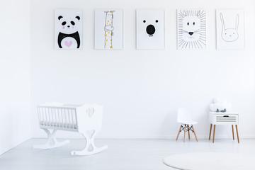 Drawings in white baby's bedroom