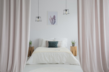 Pink curtains in bright bedroom