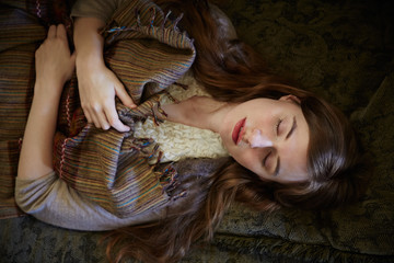 Beautiful woman napping on sofa