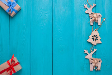 Turquoise background for Christmas cards. Background for Christmas wishes. Blue wooden planks. Christmas card. Christmas gifts. Holiday gift. Christmas deer.