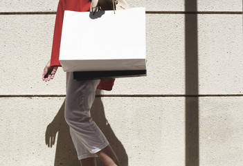 Woman walking around with shopping bag
