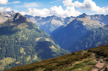 A mountain biker does off-road mountain biking in the Gastein region of Austria.