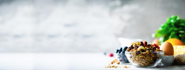 Homemade granola with milk, fresh berries, milk for breakfast. Copy space. Healthy breakfast...