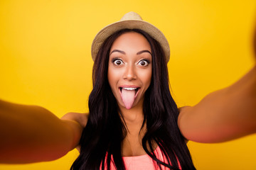 Insane, emotional expression mode! Girlish carefree pop eyed traveller in trendy beige head wear, so hot, taking selfie shot, makes memories at holiday and for her blog, messing around