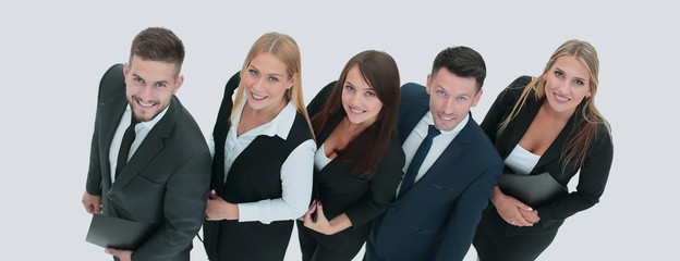 reliable and professional business team smiling and looking up