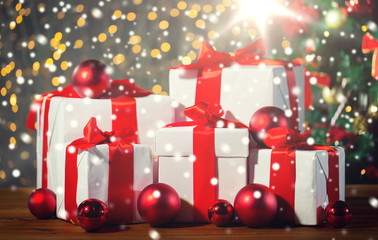 gift boxes and red balls under christmas tree