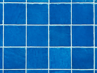 Grid of blue swimming pool tiles