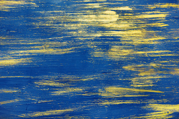 gold paint on a blue background