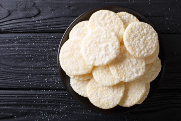 Delicious sweet rice cakes with sugar close-up on a plate. Horizontal top view