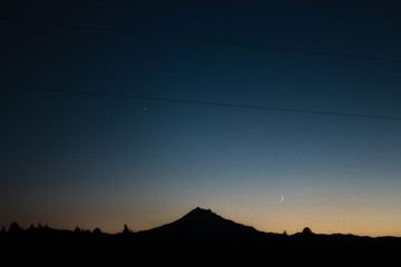 A Desert Mountain Sunset in Silhouette with Star