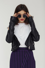Wall Mural - Young beautiful woman in a black jacket