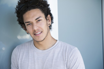 Handsome Young Male With Curly Brown Hair Smiling
