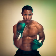 African American male boxer with fast hands