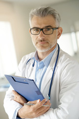 Portrait of doctor standing in office