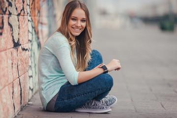 Happy woman using smartwatch