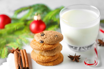 Delicious cookies and glass with milk on table