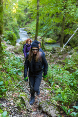 Tourists hiking on a trail