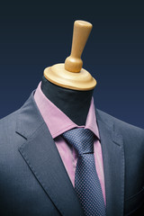 shirt tie and suit jacket on a mannequin