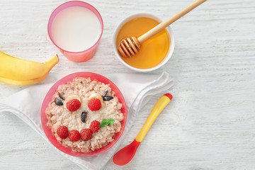 Creative oatmeal for children on table