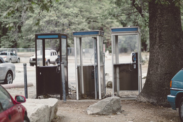 three phone booths in park