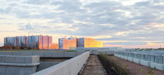 panoramas of city quarters on the beach at sunset