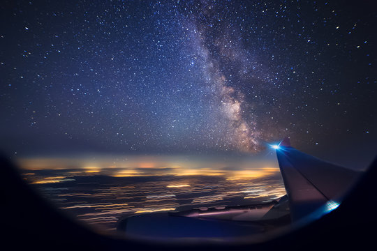 Night flight over cities. View from plane