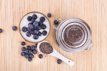 Chia seeds pudding with blueberry fruits, healthy nutritious anti-oxidant superfood.