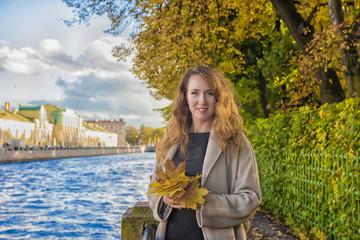 Beautiful brunette woman in autumn beige coat.
