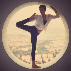Beautiful sporty fit yogi woman practices yoga asana Natarajasana - Lord Of The Dance pose in a round window