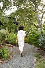 Woman walking in garden in backyard