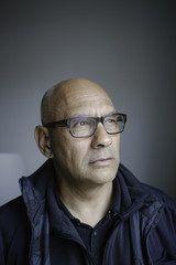 Portrait of bald man with glasses.